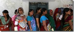 Voters line up to cast their votes outside a polling station during India's general election in Rangareddy district in the southern Indian state of Andhra Pradesh April 30, 2014. REUTERS/Danish Siddiqui